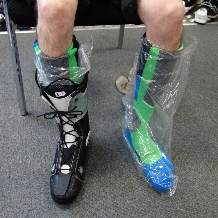 My skinny, skinny feet; padded, socked, bagged and wearing one of the liners.