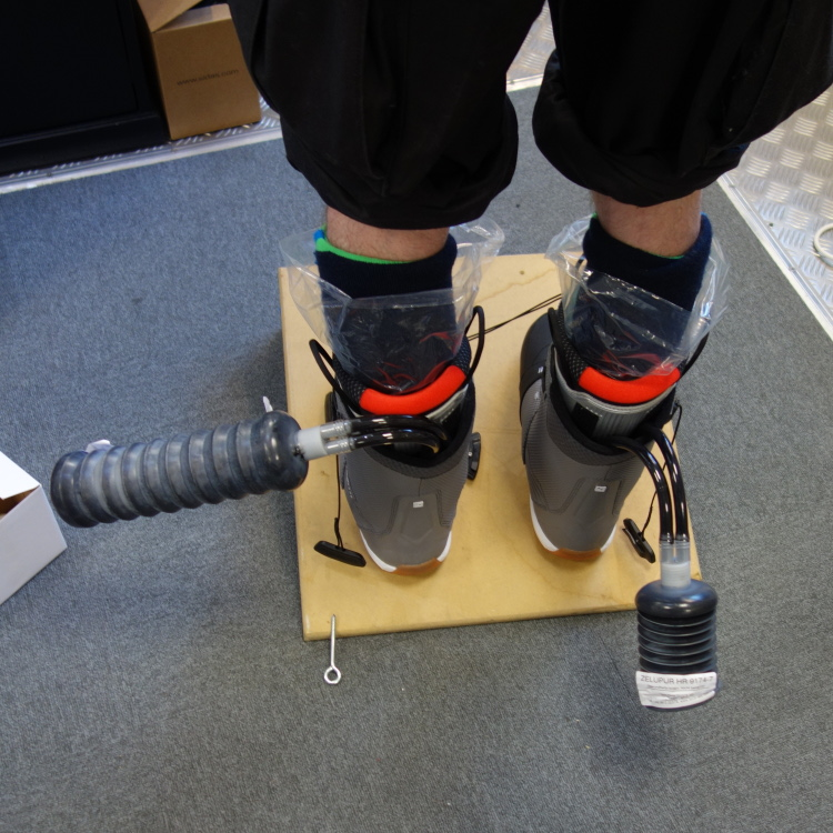 Injecting the foam: The foam in the left boot has already fully expanded. The right one is catching up.
